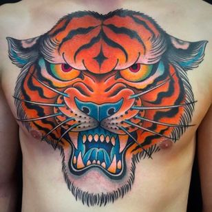 Massive tiger head chest tattoo done by Graham Beech. #GrahamBeech #NeoTraditional #AnimalTattoos #tiger #chesttattoo
