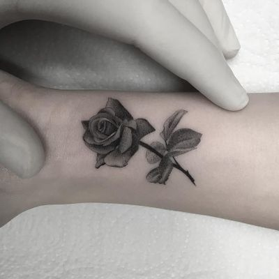Rose tattoo by Filipe Pacheco #FelipePacheco #flowertattoos #blackandgrey #realism #realistic #small #tiny #flower #floral #leaves #nature #tattoooftheday