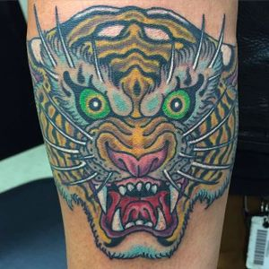 Fierce tiger head tattoo by Marc Nava. #MarcNava #tiger #traditional #tigerhead