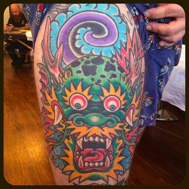 Rad dragon head thigh tattoo done by Jason Brooks. #Jasonbrooks #GreatWaveTattoo #boldtattoos #TraditionalTattoo #dragon #dragonhead
