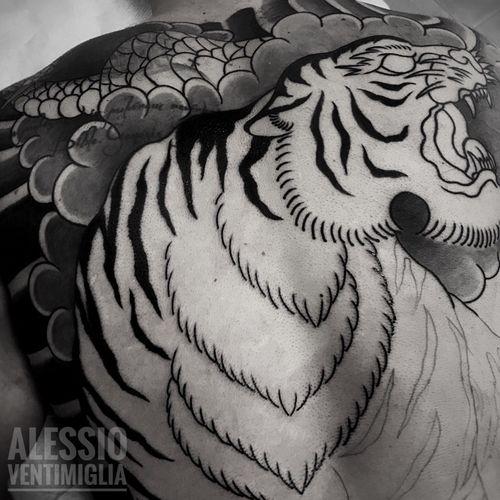 ⚡️Cover Up in progress⚡️ @delight_tattoo_needles #tiger #ryu  #delightneedles #irezumism #picoftheday #reclaimthedots #irezumistudy #video #videooftheday #japan #japantattoo #dragon #babes #inkedbabes #awesome #best #backpack #backpiece #tora #tattoo #tattoolife #traditional #irezumism #ink #reclaimthedots #tattoodo #art #wabori #TattoodoApp