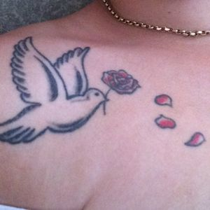 This tattoo has meaning and is for my son. The dove to represent peace and the red rose to represent my love for him. ❤️