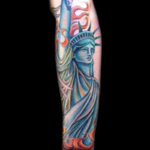 Tattoo by Lark Tattoo artist/owner Bruce Kaplan.  #color #colorful #statue #statueofliberty #colorful #fire #flame #halfsleeve #arm #brucekaplan #owner #artist #ownerartist #artistowner #LarkTattoo #LarkTattooWestbury #NY #BestOfLongIsland #VotedBestOfLongIsland #BestOfNYC #VotedBestOfNYC #VotedNumber1 #LongIsland #NYC #TattoosEvenMomWouldLove