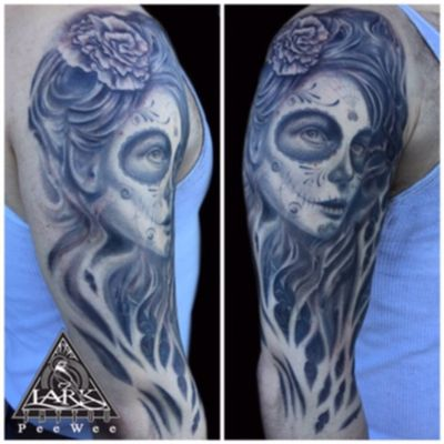 Black and gray tattoo of day of the dead style female portrait by Lark Tattoo artist PeeWee #blackandgrey #blackandgreytattoos #blackandgray #blackandgreyrealism #dayofthedead #sugarskulltattoo #sugar