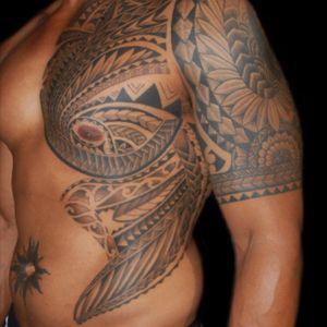 Tattoo by Simone Lubrani #polynesian #polynesiantattoo #PolynesianTattoos #PolynesianDesigns #tribal #tribaltattoo #tribalmaori #polynesianstyle #blackink #blacktattoo #blackinktattoo #black #ribs #ribstattoo #sidetattoo #sholder #sholdertattoo #sholdercaptattoo #arm #armtattoo #halfsleeve #guyswithhalfsleeve #halfsleevetattoo #simonelubrani #artist #tattoo #tattoos #tat #tats #tatts #tatted #tattedup #tattoist #tattooed #tattoooftheday #inked #inkedup #ink #tattoooftheday #amazingink #bodyart #LarkTattoo #LarkTattooWestbury #NY #BestOfLongIsland #VotedBestOfLongIsland #BestOfNYC #VotedBestOfNYC #VotedNumber1 #LongIsland #LongIslandNY #NewYork #NYC #TattoosEvenMomWouldLove #NassauCounty