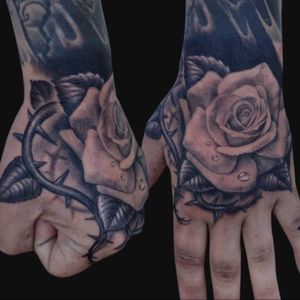 Beautiful thorn and rose hand tattoo #hand #rose #thorn