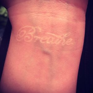 My first tattoo at 18!! I wanted something super meaningful, elegant and inconspicuous. It's a really nice reminder to take a moment before stressing out. Having such fair skin, it turned out awesome! I've had it touched up once, and that was in 2013. And no, it's not flurorescent. #breathe #whiteknk #oshkosh #wisconsin #simple #fairskin