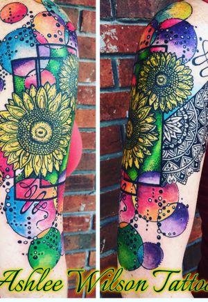 One of my abstract watercolor paintings tranformed into a beautiful half sleeve! #abstracttattoo #watercolortattoo #sunflowertattoo #mandalatattoo #geometrictattoo #eternalinks