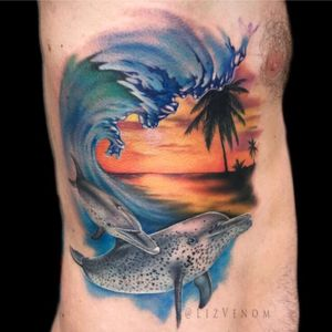 A #wave and #dolphin tattoo i did to represent my client and his son. #wavetattoo #tropical #palmtree #subset #waves #beach #dolphins #underwater #ribs #side #large #color #colour #realism #realistic #wildlife #tropics #colourful #amazing #beautiful #painting #painterly #electrum #intenze #neotat #ohanaorganics #lizvenom #helios #painfulpleasures #melbourne #australia #edmonton #canada