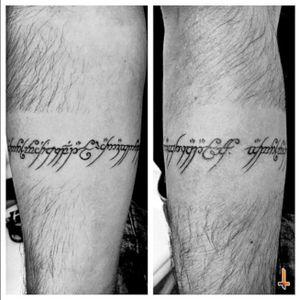 Nº395 One Ring to rule them all, One Ring to find them, One Ring to bring them all and in the darkness bind them. #tattoo #tattooed #ink #inked #lotr #lordoftherings #lordoftheringstattoo #onering #ringofpower #Crackofdoom #mordor #sauron #runes #elf #elfish #elfishrunes #jrrtolkien #lettering #letteringtattoo #darklord #bracelet #bracelettattoo #eternalink #liningblack #bylazlodasilva