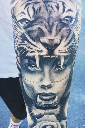 Half Sleeve.   Tiger Headress with roses around wrist, and a galaxy/nebula backside.