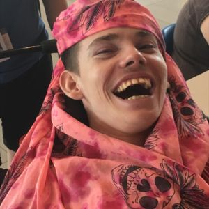 He may be in a wheel chair and not have ink. But he sure can rock my skull scarf pirate style! #Ilovemyjobxo