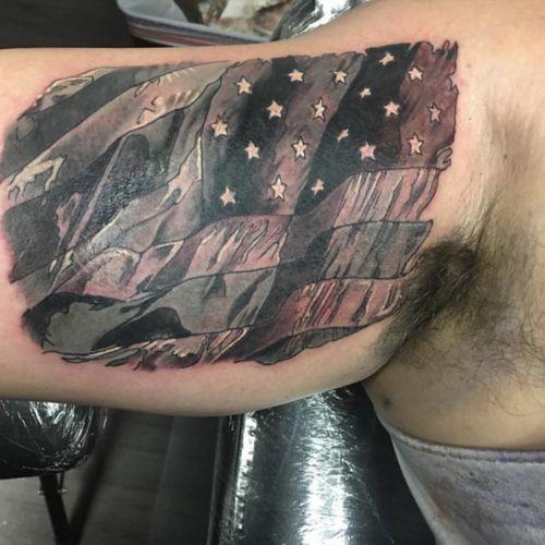 Flag tattoo for a client! #americanflag #flag #blackandgrey #blackandgreytattoo #greywash #realistic #biceptattoo #patriotism #america #tattoo #ink #inked #original #customtattoo #customdesign
