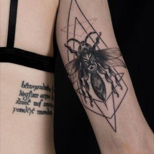 Gothic illustrative hornet by resident tattooist Julian Rozis
