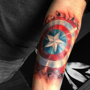Awesome piece by #maydaytattooco artist #carolynelaine #captainamerica #color #colortattoo #arm