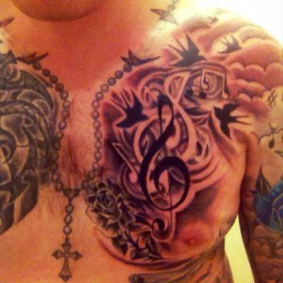 Music chest tattoo snd rosary beads #musictattoo #rosarybeads #trebleclef