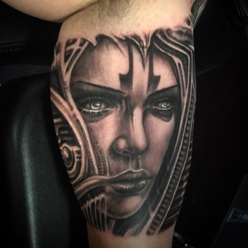 Womans face with biomech. Done by @jeremiahbarba out of Conckave Art Studio Sunset Beach CA.