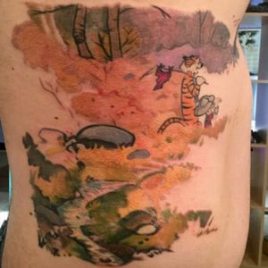 Calvin & Hobbes watercolor tattoo from Rebecca Houston at Heathen Ink Tattoos, Summit, IL. Tattooheathen.com #calvinandhobbes #watercolortattoo