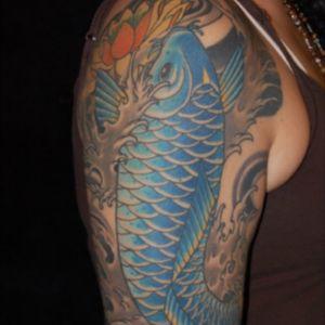 Tattoo by Simone Lubrani #japanesewave #fingerwaves #lotus #lotustattoo #japaneselotus #koi #koifish #koifishtattoo #bluekoi #arm #armtattoo #halfsleeve #halfsleevetattoo #bluekoifish #japanese #japanesetattoo #japanesekoi #japaneseflower #colortattoo #simonelubrani #artist #tattoo #tattoos #tat #tats #tatts #tatted #tattedup #tattoist #tattooed #tattoooftheday #inked #inkedup #ink #tattoooftheday #amazingink #bodyart #LarkTattoo #LarkTattooWestbury #NY #BestOfLongIsland #VotedBestOfLongIsland #BestOfNYC #VotedBestOfNYC #VotedNumber1 #LongIsland #LongIslandNY #NewYork #NYC #TattoosEvenMomWouldLove #NassauCounty
