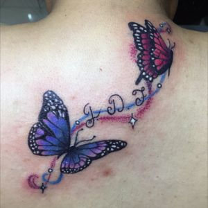 #buterfly #buterflytattoo #letters #colorful #colorfultattoo #smalltattoo #backtattoo #girly #girltattoos
