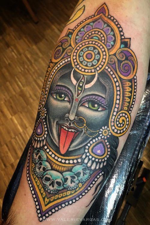 Kali head on forearm