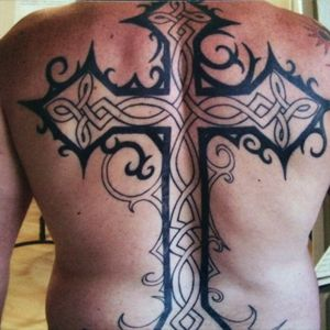 Back tattoo of a cross with celtic knots
