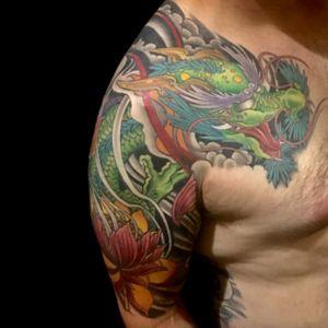 Tattoo by Lark Tattoo @larktattoo artist/owner Bruce Kaplan. #tattoo #tattoos #tat #tats #tatts #tatted #tattoist #tattooed #tattoooftheday #tattoooftheday #amazingink #tattooig #tattoosofinstagram #larktattoo #dragon #dragontattoo #lotus #lotustattoo #japanesetattoo #japanesetattoos #colortattoo #colortattoos #halfsleevetattoo #armtattoo #armtattoos #chesttattoo #chesttattoos