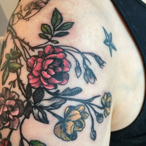 The flowers are a first step of a quarter sleeve peas that I will be getting done within the next few months. #flowers #tattooflowers #pretty #feminine #quartersleeve