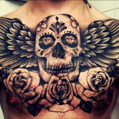 My chest peice by Chris at #magnumstattoostudio #chestpiece #sugarskull