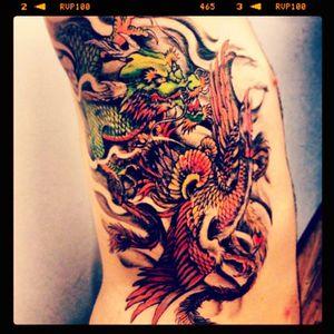Protecter of new beginings #dragon #pheonix #smoke #ribs #colour #colourtattoo #dragontattoo #pheonixtattoo