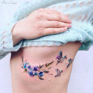 Pretty flowers and birds 🌸🌷🐥 by @pissaro_tattoo via Instagram #watercolor #geometry #linework #flowers #birds #pissarotattoo #floral #subtle