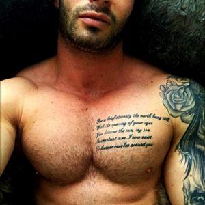 Chest script and start of left sleeve #inkedboy #guyswithink #tattooedguys #blackandgrey #chest #roses #script