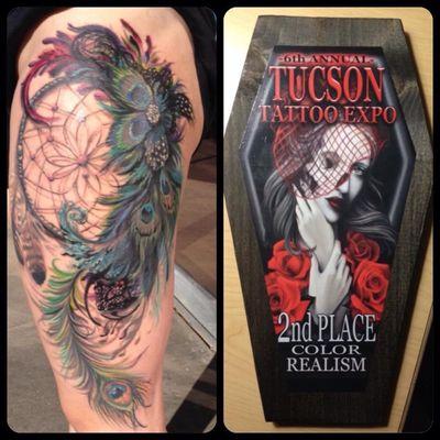Custom dream catcher by Joshua Marchand, Third Alliance Tattoo Studio, Alamogordo, NM #dreamcatcher #peacockfeather #thightattoo #dreamcatchertattoo #JoshMarchand