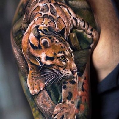 Created by Yomico Moreno. His animal portraits have been outstanding, here is a Jaguar to add to the list. #colortattoo #bigcat #nyc #lastritestattoo #yomicoart #realism #realistictattoo